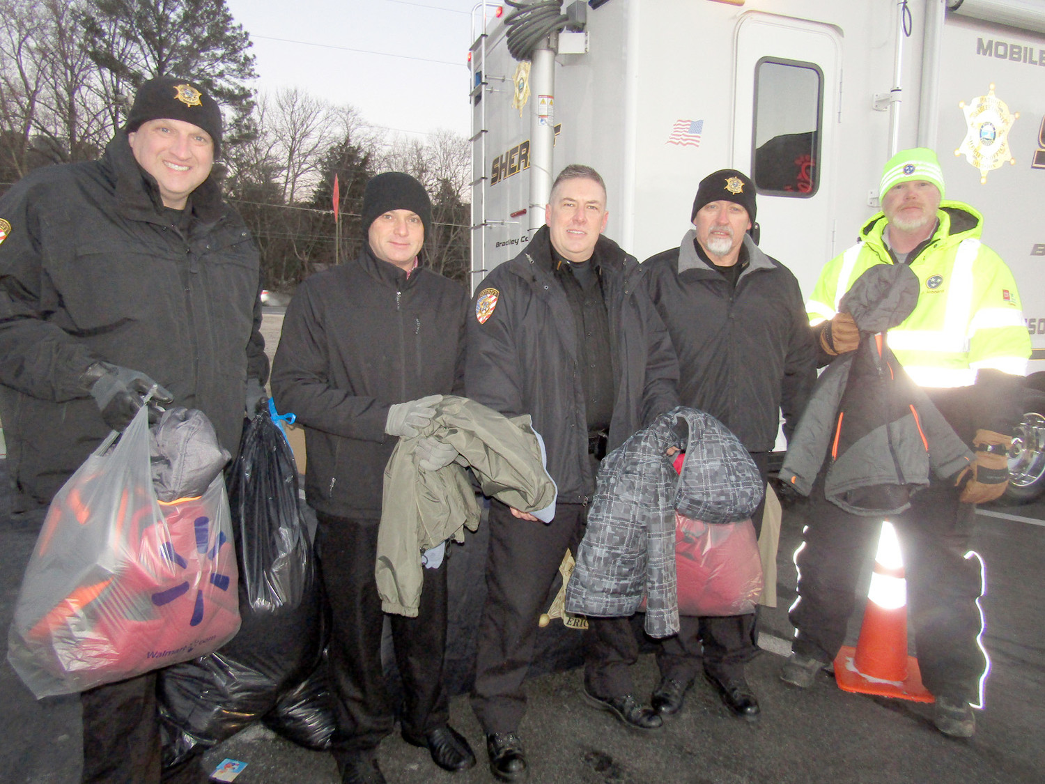 "Lined up to collect ""Coats For The Cold"" during the annual drive are, from left, Sheriff Eric Watson, Steve Colley of Chick-fil-A, BCSO Lt. Tim Mason, BCSO Capt. Dennis Goins, and Jeff Hibbert of TDOT."