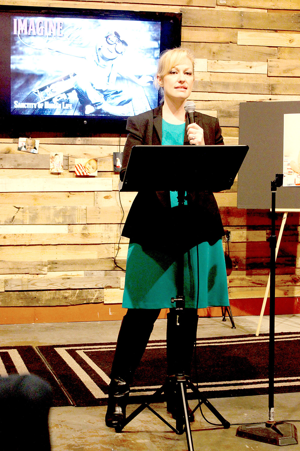 TRACIE SHELLHOUSE, CEO of New Hope Pregnancy Care Center, speaks during the orqanization's Celebration of Life event Monday.