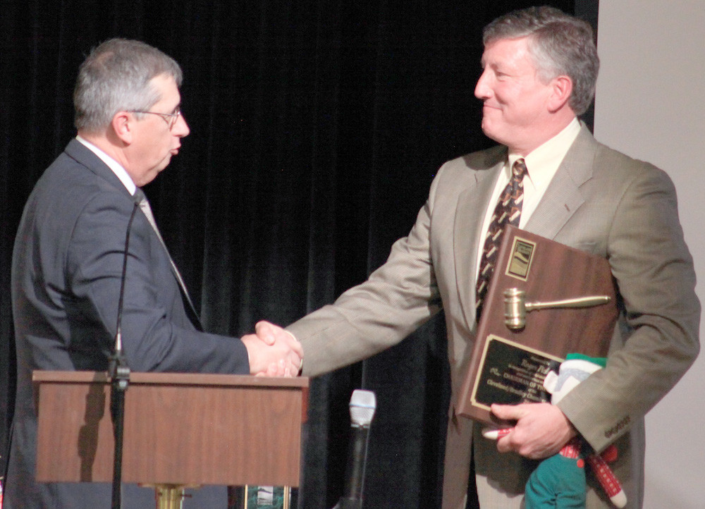 THE 2018 BRADLEY/CLEVELAND Chamber of Commerce chairman of the board, Kevin Moore, left, presents a plaque and shakes hands with the 2017 chairman, Roger Pickett.