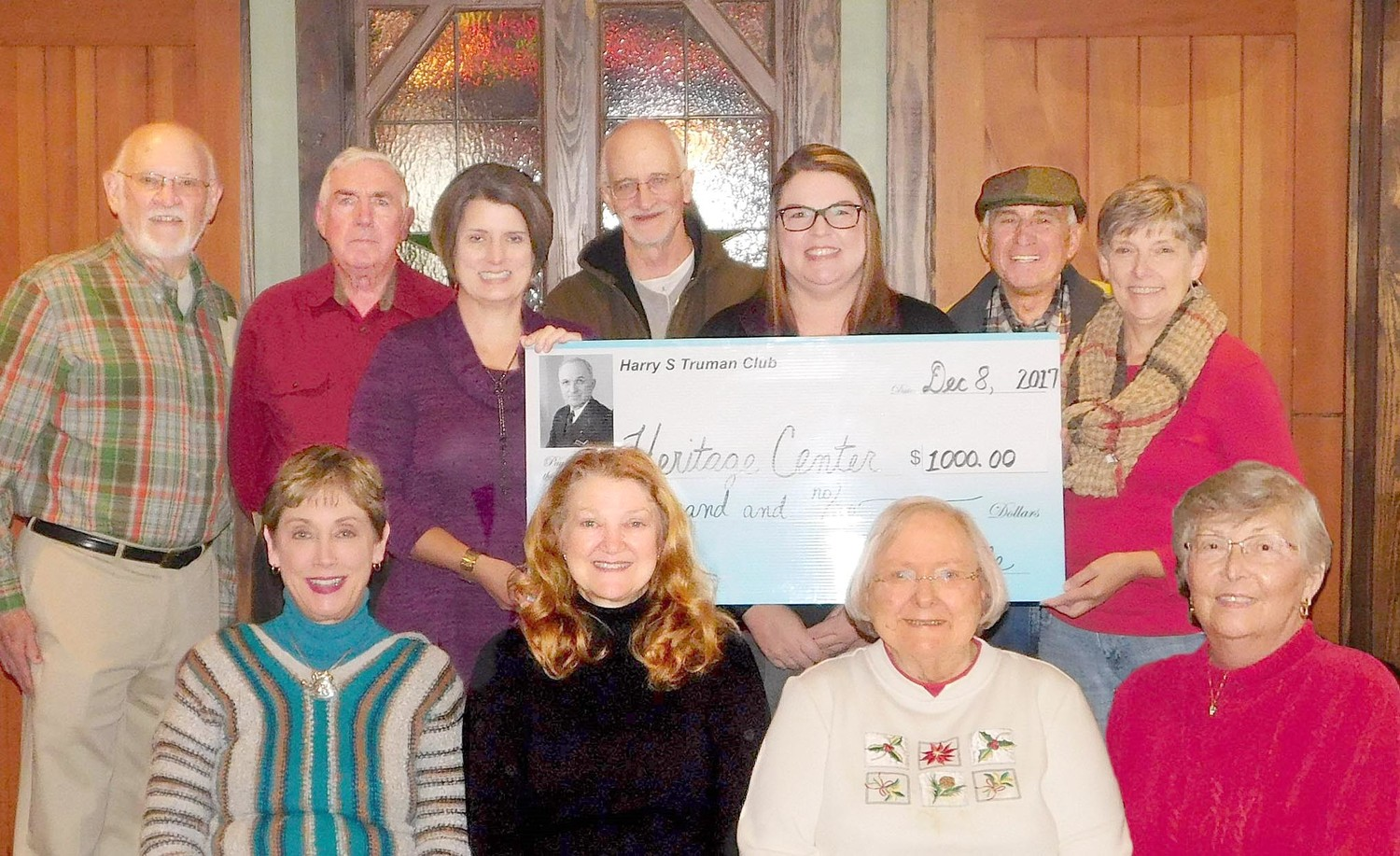 THE HARRY S. TRUMAN Club of Bradley County has donated $1,000 to the Hiwassee River Heritage Center in memory of Bob Hughes. Hughes, who served as Pike Road superintendent of Bradley County for years, was a prominent and highly respected member of the Charleston community. This gift by the Truman Club follows an earlier donation of $1,000 to support the purchase and renovation of the Heritage Center building. Seated, from left, are Sally Love, Cindy Logan, Mary Guthrie and Carol Beck; standing, Doug Pirkle, Mike Callaway, Ginger Wilson Buchanan, Bob Hughes' daughter, Bobbie Jo Henry, Zane Harris and Darlene Goins, Heritage Center manager.