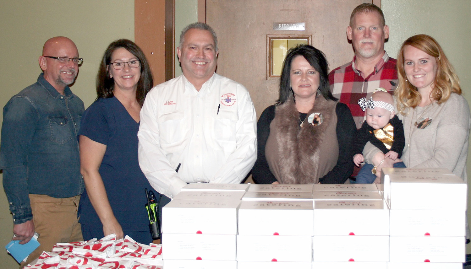 THE ORGANIZERS and speakers of the event stand with their bounty of Chick-fil-A before event's start. From left are Danny Marshall, Clingan Ridge; Tricia Marshall, Clingan Ridge; Stan Clark, Bradley County EMS Assistant Director; Sherry Wright, Maranda Wright's mother; Tim Wright, Maranda Wright's father; and Emma Ezell, Maranda Wright's sister. Little Addie Jay Ezell, Maranda Wright's niece, is being held by Emma Ezell.