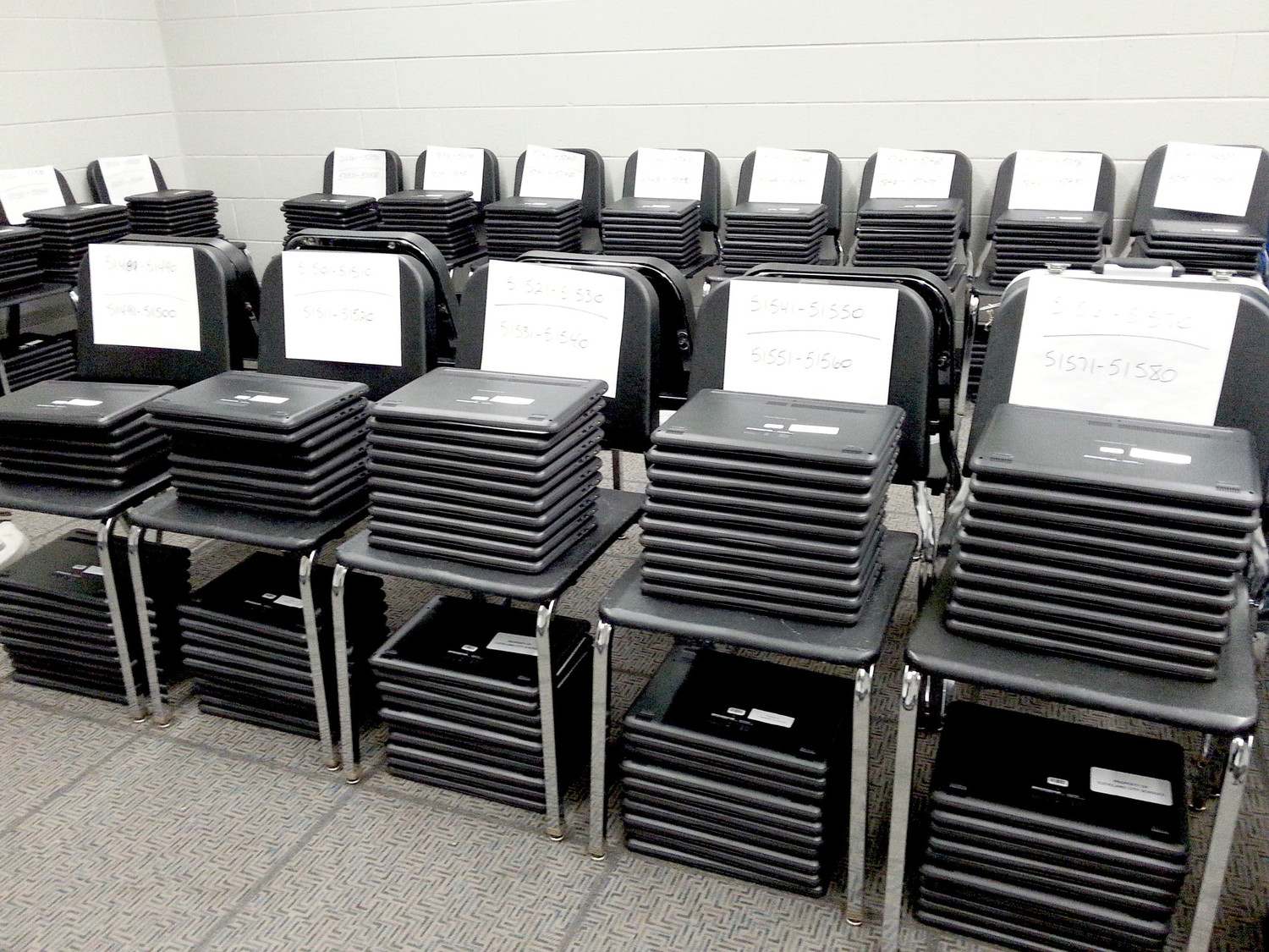 STACKS AND STACKS of Google Chromebook laptops wait to be picked up by Cleveland Middle School students. Each of the school's close to 1,400 students received one.