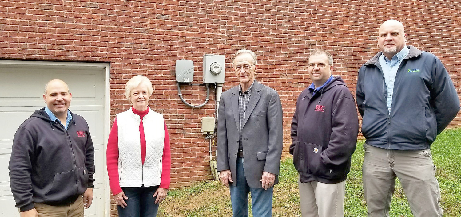 VEC'S first broadband installation is pictured with, from left to right, VEC's Jeremy White, Mary Hollifield, Charles Hollifield, VEC's Chuck Dake and Twin Lakes' Tom Jolley.