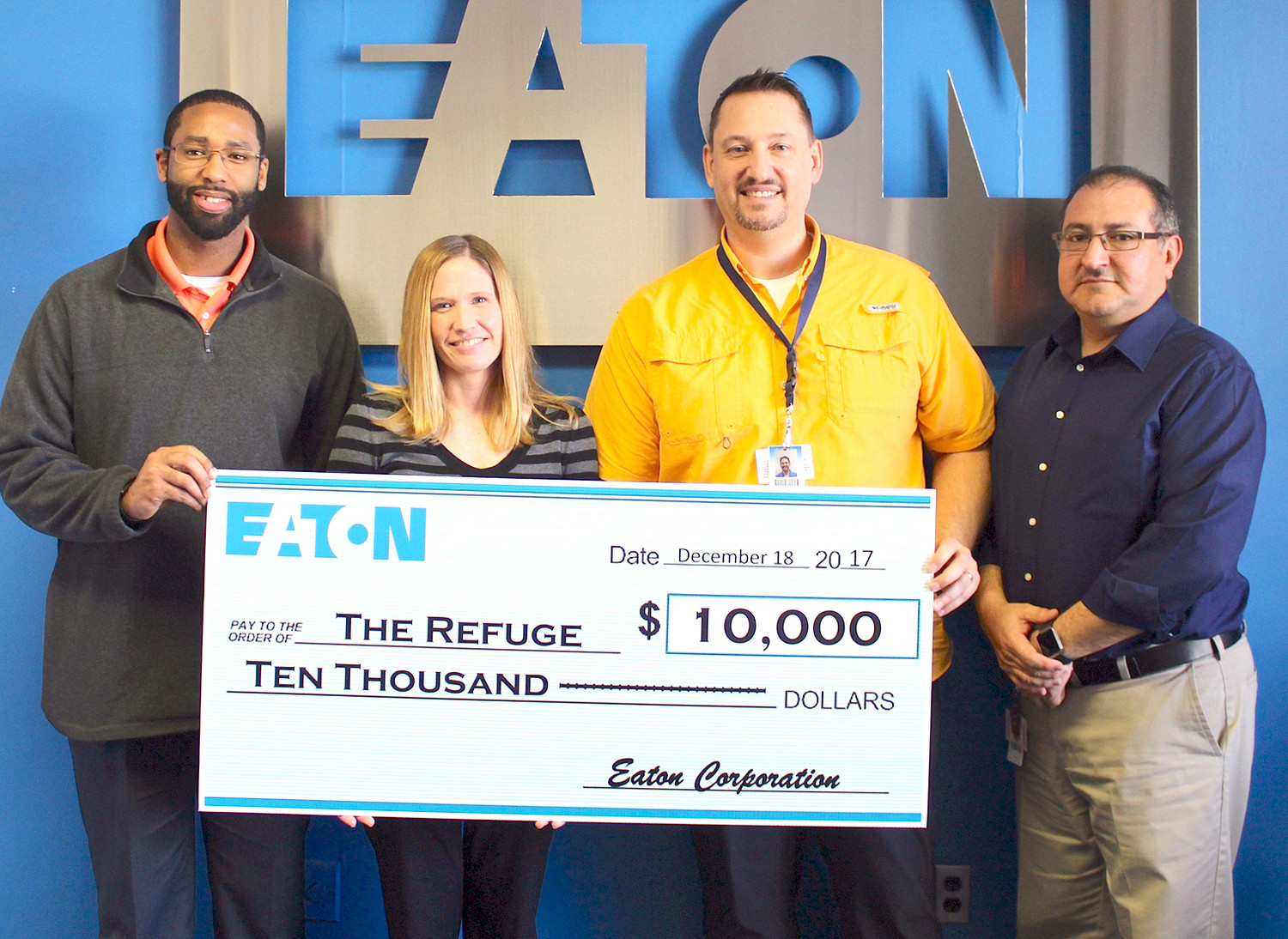 EATON CORPORATION recently presented a $10,000 grant to local nonprofit organization The Refuge. From left are Michael Patterson, human resources manager at Eaton; Kelli Kyle, chief operations officer at The Refuge; Quincey Bentley, senior materials planner at Eaton; and Cesar Escarcega, plant manager at Eaton.