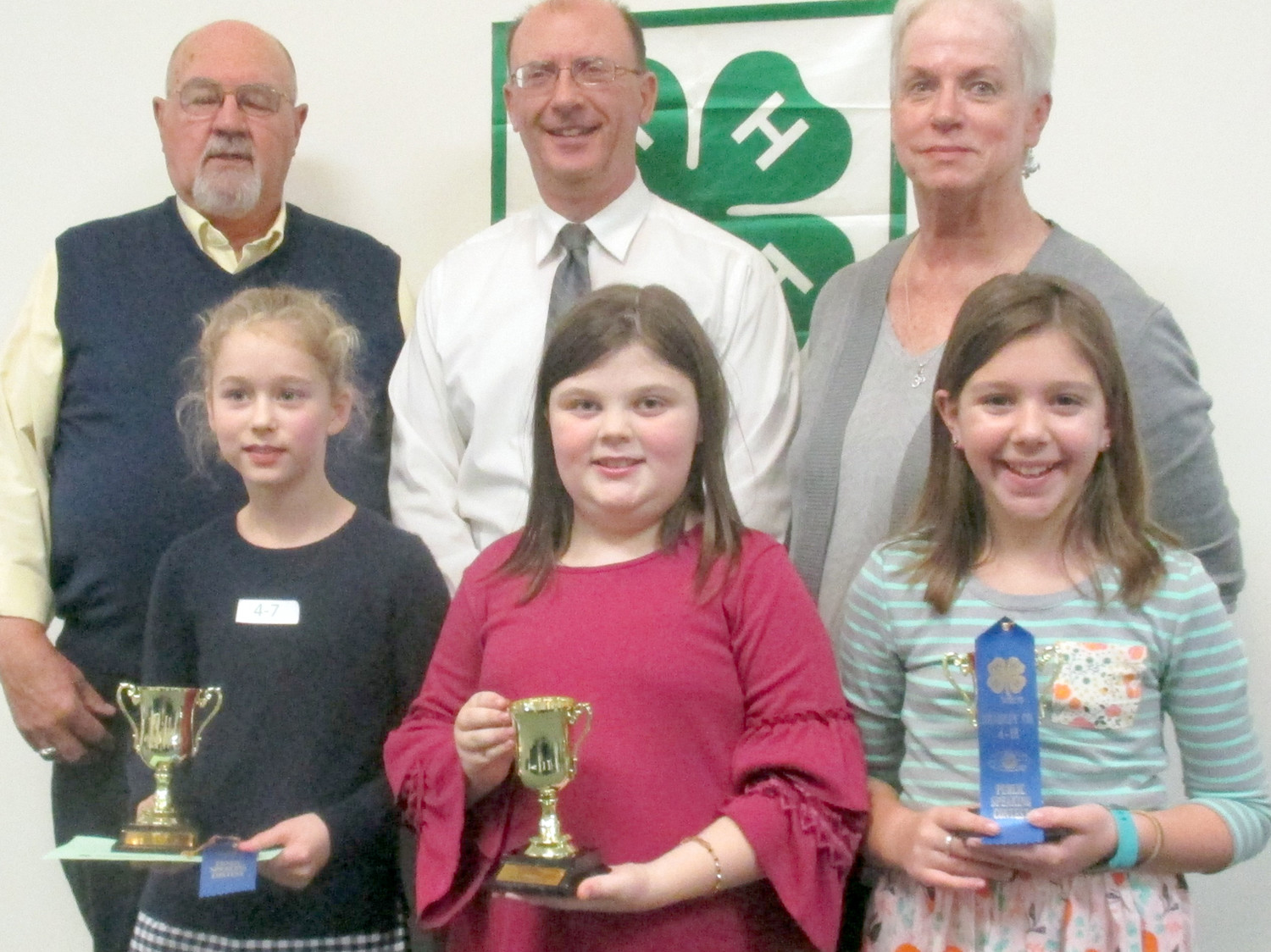 Bradley County 4-H Sub County Public Speaking Contest Winners for fourth grade were, front from left, Anna LaDuke from Taylor Elementary; Amelia DeBond from Charleston Elementary; and Olivia Parker from Tennessee Christian Preparatory School. Judges were Doug Greene, John Hood and Gayle Mingledorff.