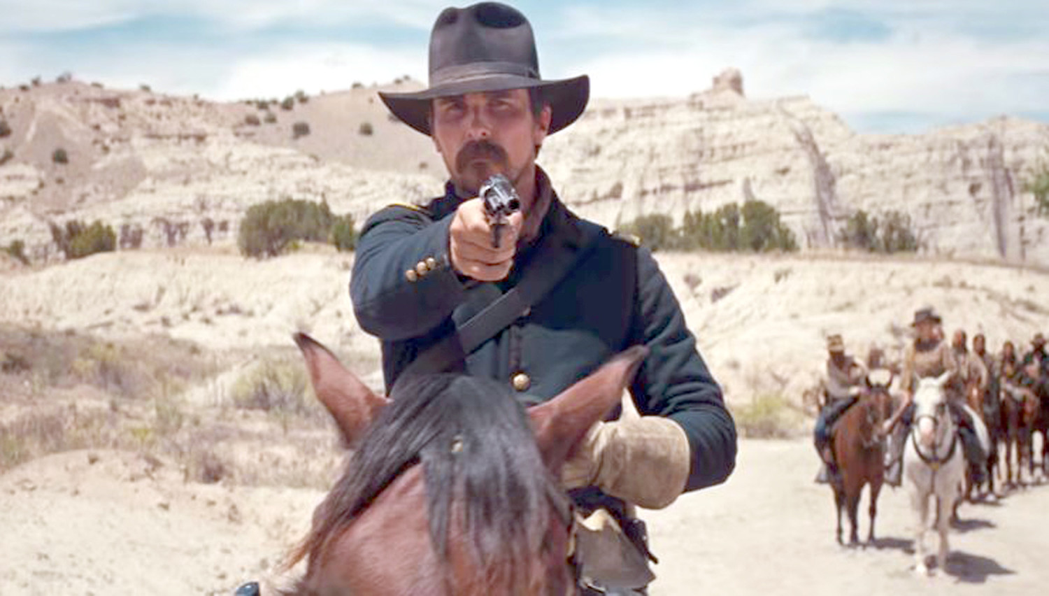 "Christian Bale portrays U.S. Cavalry Captain Joseph ""Joe"" Blocker, a hardened veteran who despises Native Americans, yet comes to respect them and their culture in ""Hostiles."""