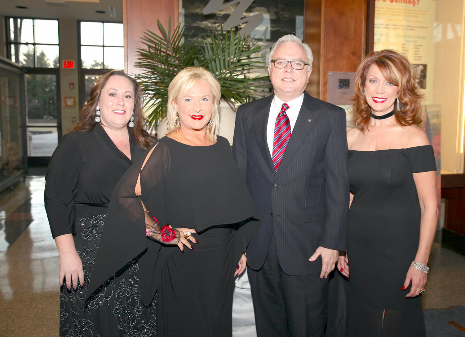 ROTARY CLUB OF CLEVELAND held their annual gala, this year titled Under the Tuscan Stars, at the Museum Center at Five Points on Friday, Feb. 2.  Pictured from left are Chair of the Rotary Auction Committee, Amanda Nelson Troyer, Pam Nelson, David Carroll and Kim Casteel.
