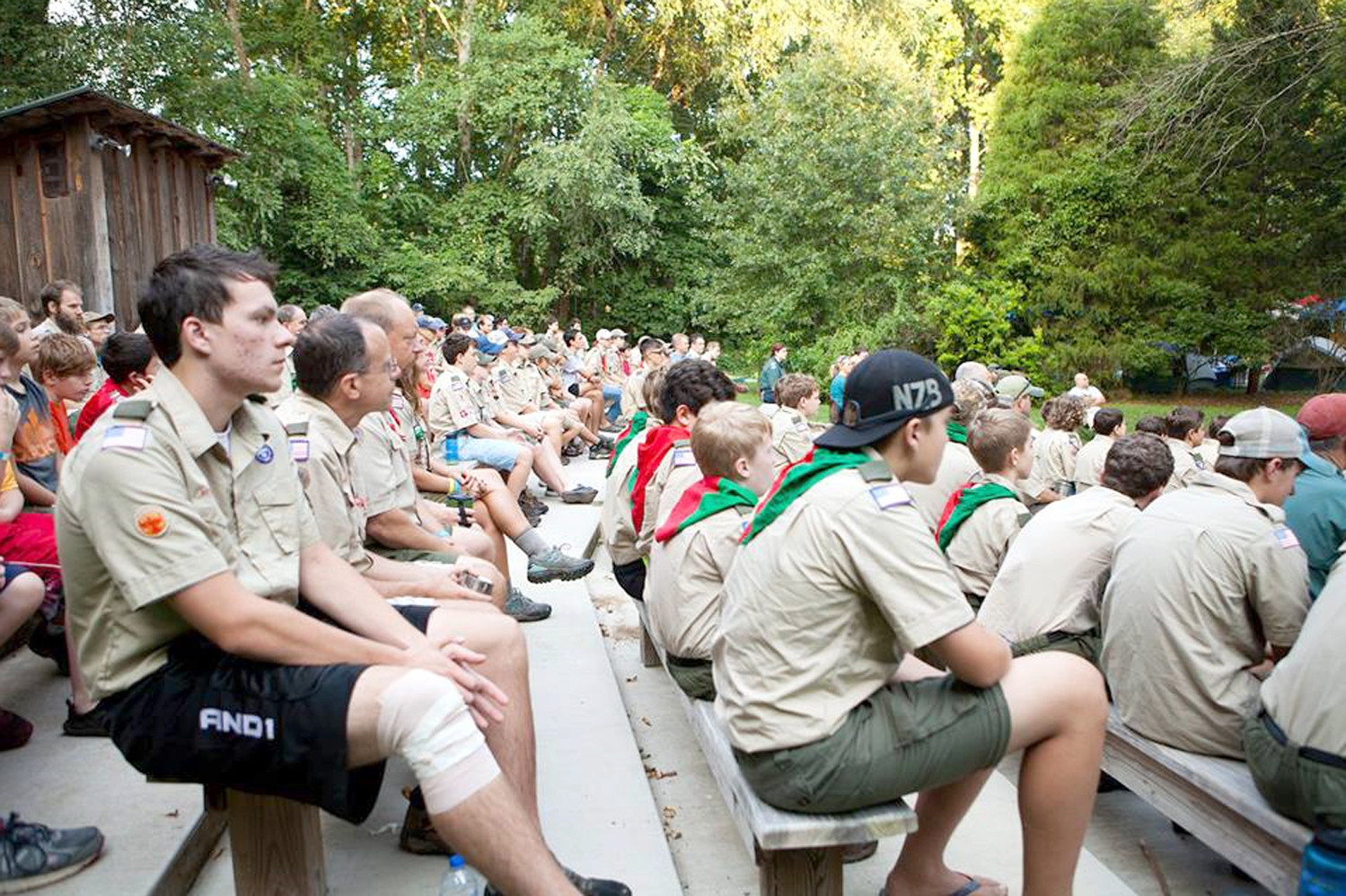 A large group of Boy Scouts meet at an outdoor amphitheater. Events such as the scouts' fundraiser help them raise money to continue mentoring young minds and helping the community as a result.