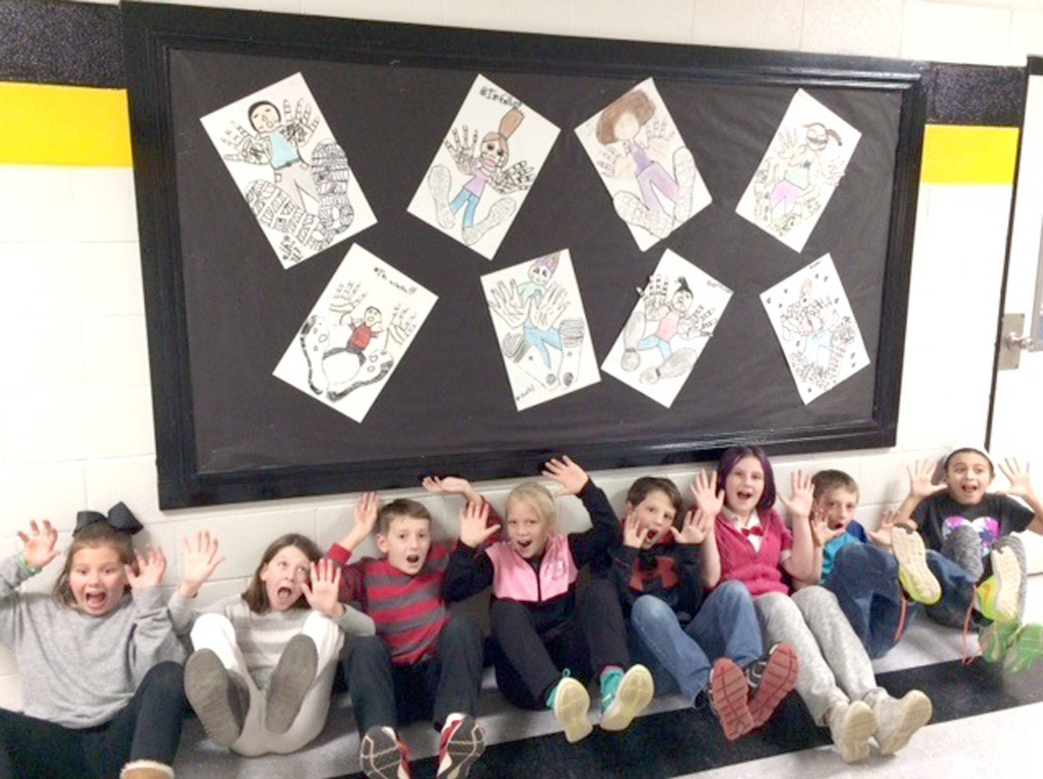 STUDENTS recently gathered under their distance perception project at Hopewell Elementary. Ashlyn Henry (from left) Emily Biller, Nick Shifley, Lyla Sims, Jeremiah Pugh, Lillian Flowers, Landon Williams, and Ava Adams participated in Art Smart enrichment projects at Hopewell Elementary. Students learned multiple techniques for sketching, distance perception, watercolor strokes, and tape resistance creations to express poetry.