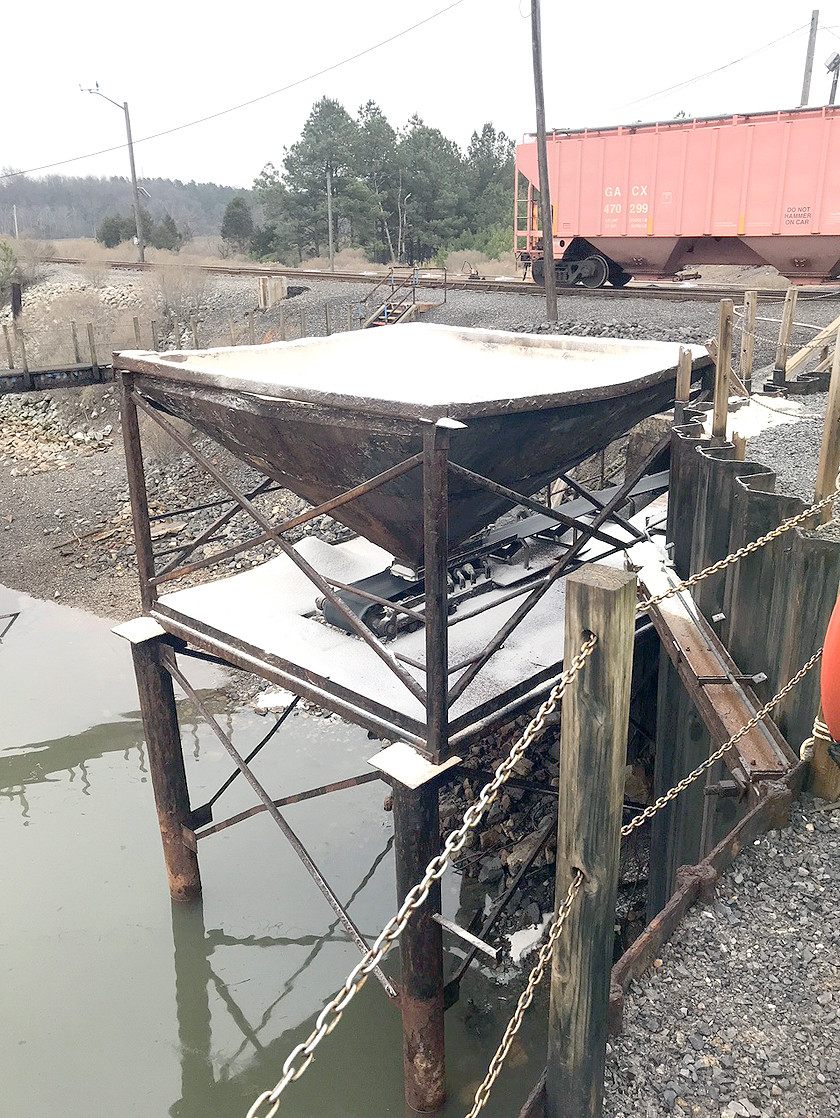 THIS PHOTO shows a conveyor belt apparatus at Smoky Mountain Transfer Corporation's facility in Charleston. Another apparatus with a scoop device was unloading product onto the conveyor belt Tuesday morning when it leaked hydraulic fluid into the Hiwassee River.
