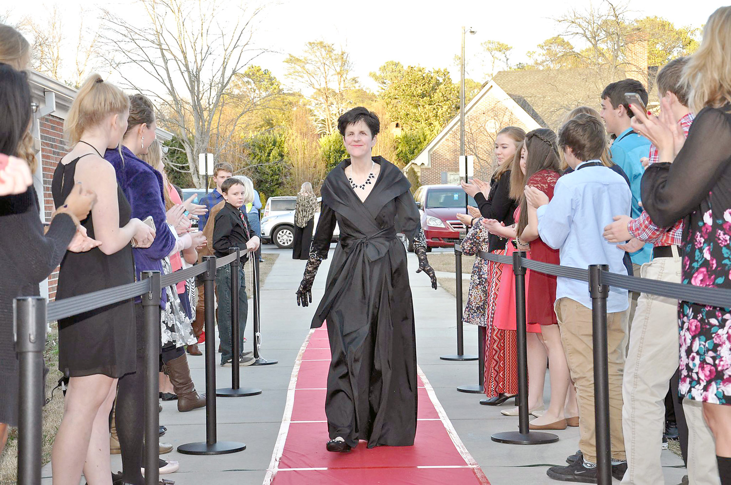 "HEATHER COLLINS walks the red carpet going into First Presbyterian Church for last year's ""Night to Shine"" event."