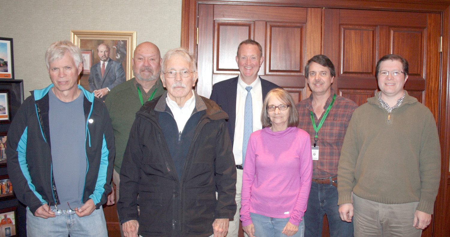 The group of historians and businesspeople who are working on bringing to light all of the images that were recently discovered pose for a photo at Jones Management. From left are Mitchell Guinn, Rufus Triplett, Charlie Corn, Toby Pendergrass, Stephanie Holmes, Jeff Pettit and Bryan Reed.