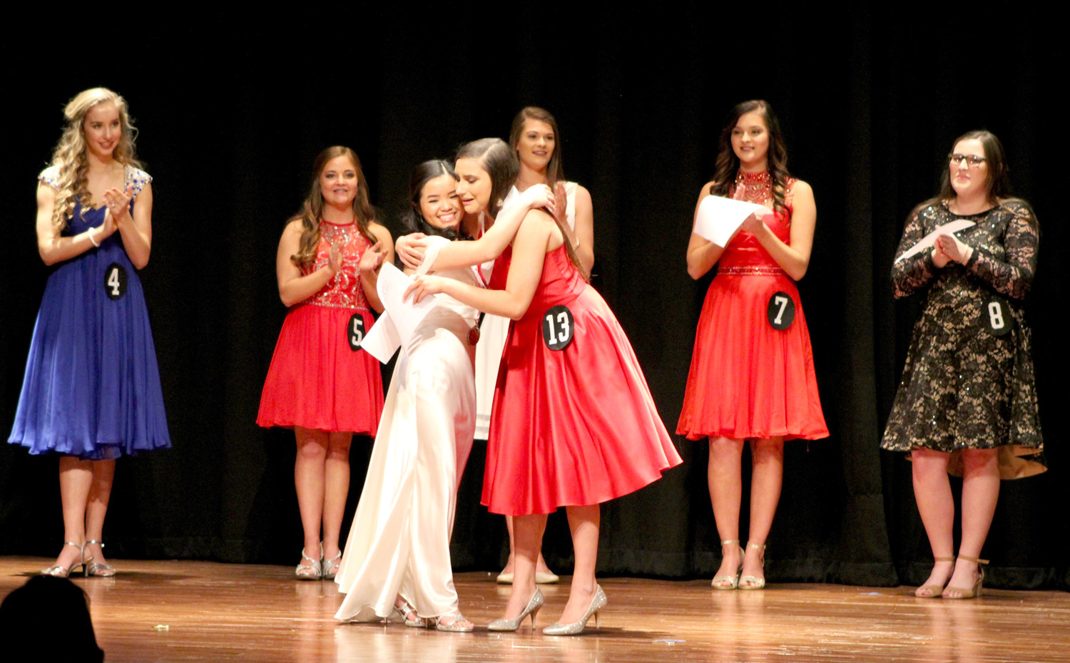 PASSING on her title, 2018 Distinguished Young Woman of Cleveland Jasmine Ngo, left, congratulates the 2019 title-holder, Elena Burton.
