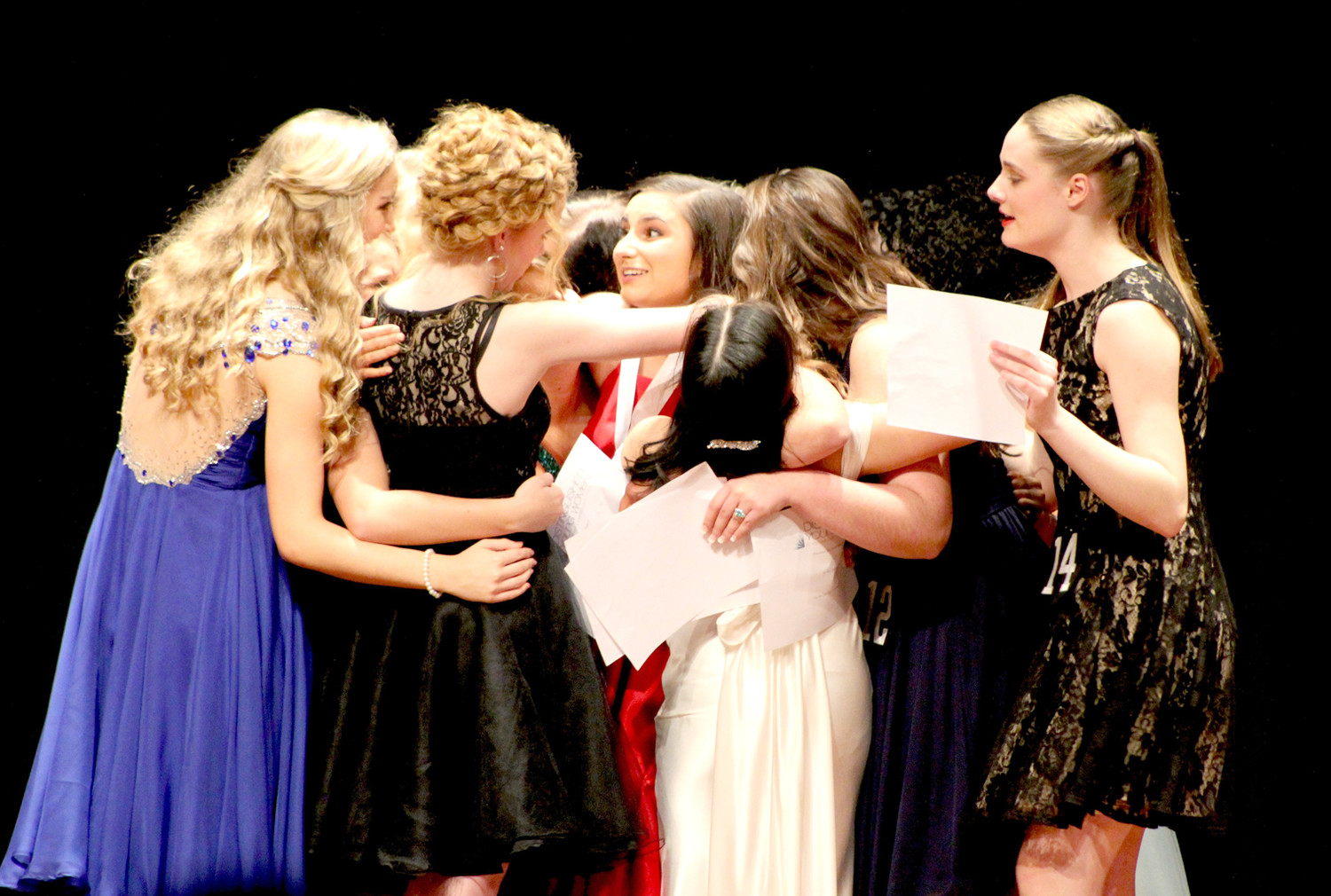 SHOCKED by her win, Elena Burton is surrounded by the other competitors who rushed to congratulate her after she was named the 2019 Distinguished Young Woman of Cleveland.