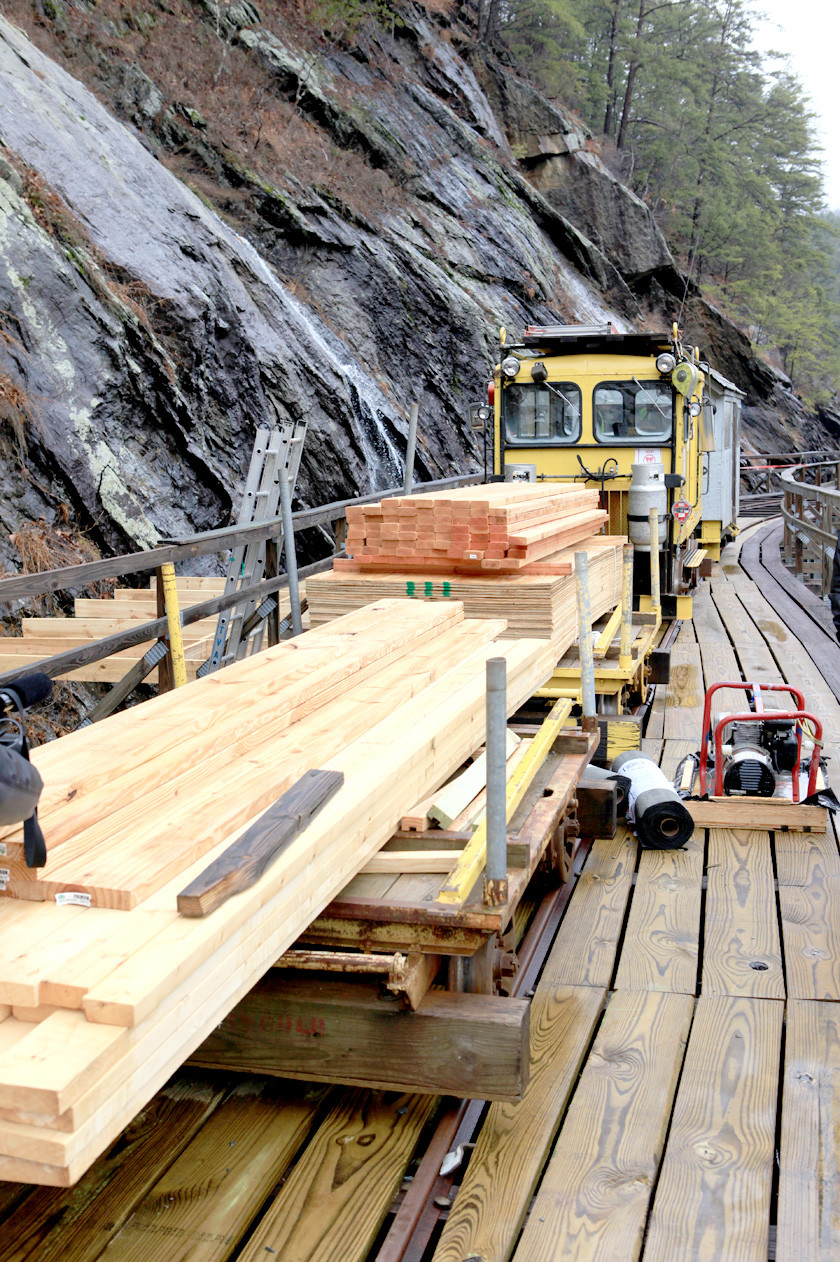 CONSTRUCTION materials are in place for the construction of a shelter for workers who will repair the Ocoee Flume. After the structure is in place and fallen rock debris removed, reconstruction of the damaged flume will begin.