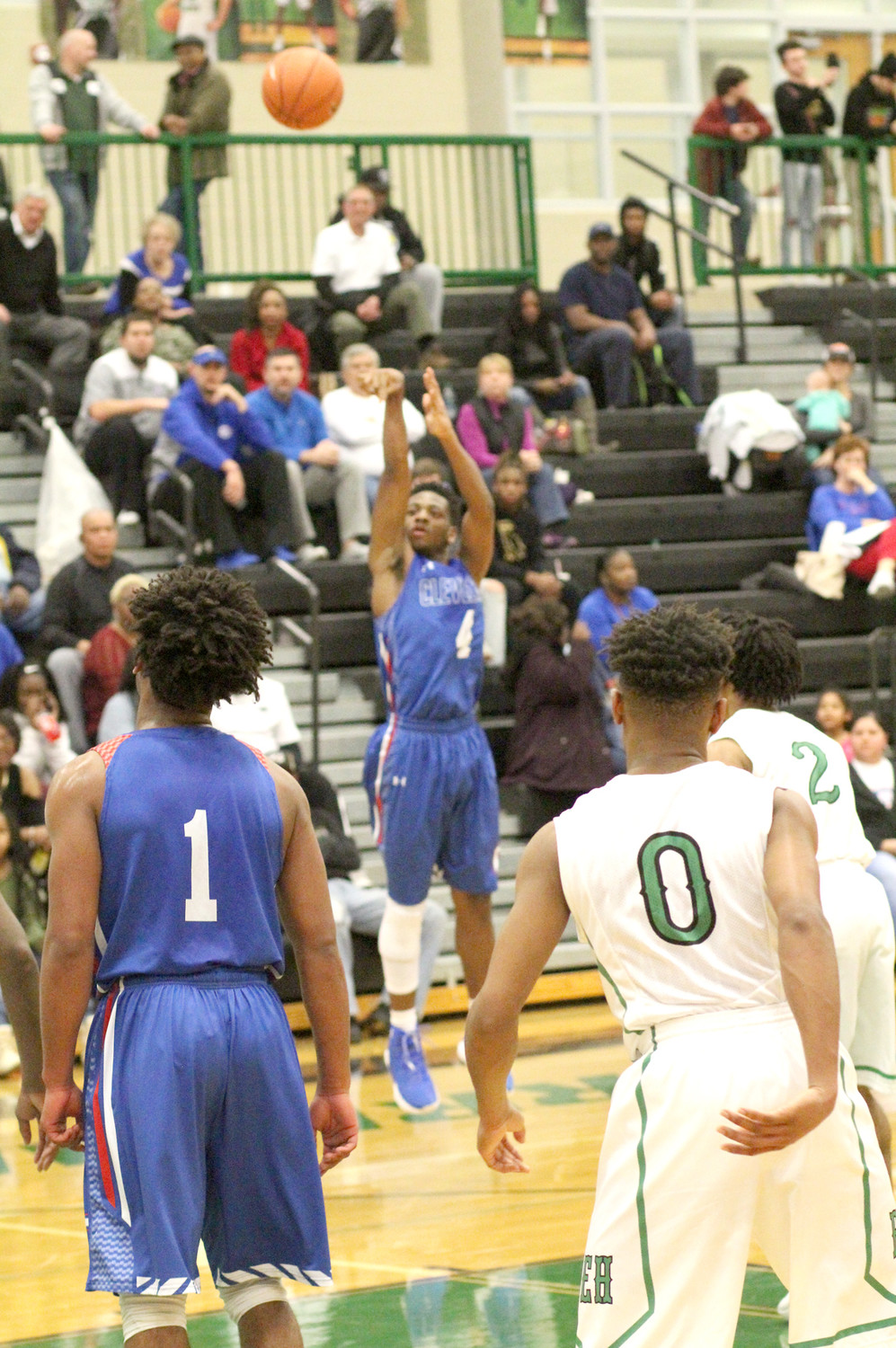 CLEVELAND SENIOR Mullek Bradford puts up a 3-point shot during an 83-65 victory at East Hamilton on Thursday night. Bradford finished with 18 points and 10 assists.