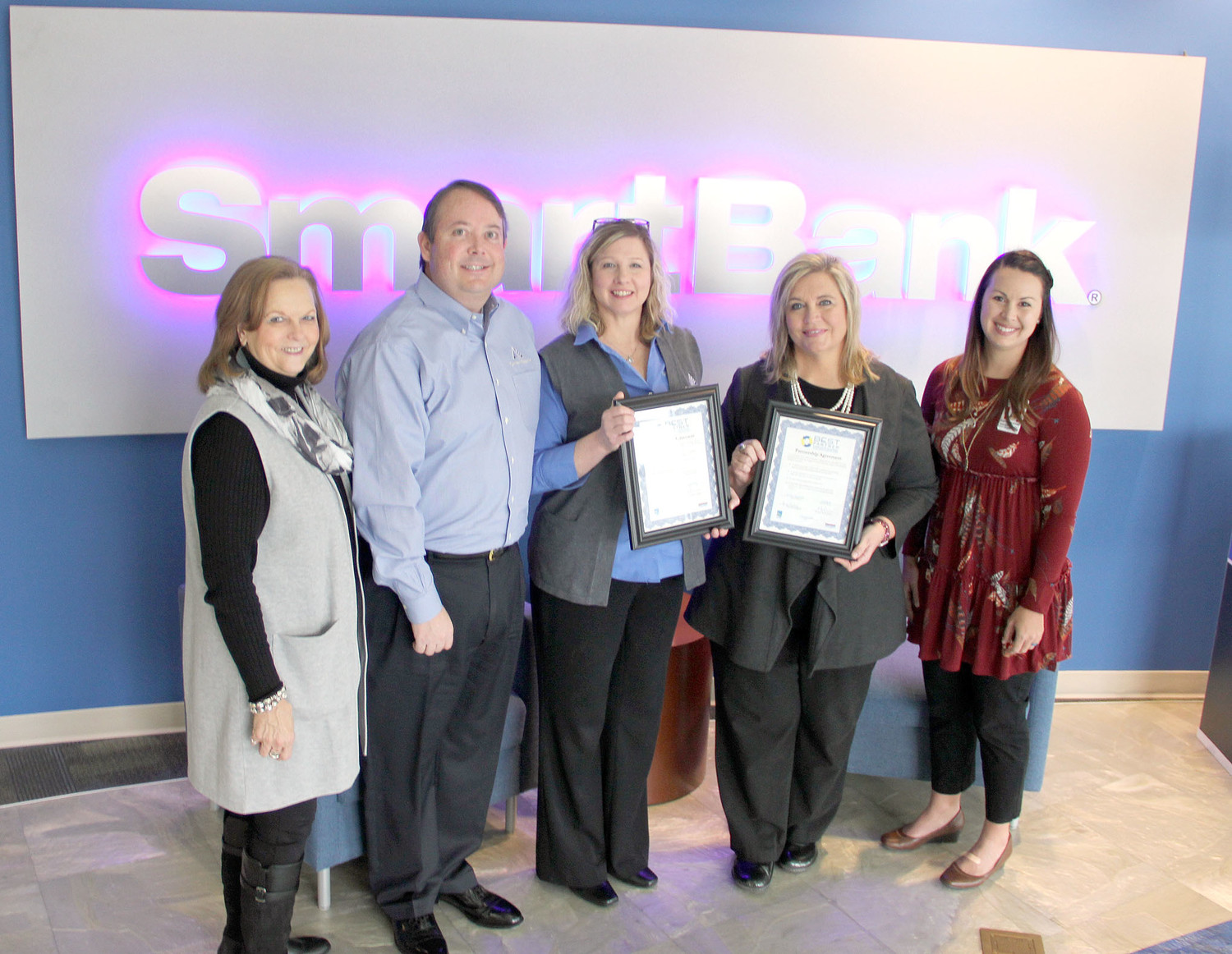 PROUDLY displaying their BEST Partnership certificates from SmartBank are Matt Jenne, market leader; and Sandy McBride, branch manager; with E.L. Ross Elementary Principal Lisa Earby and Stephanie Stone, assistant principal, along with Sherry Crye, Chamber of Commerce director of workforce development, left.