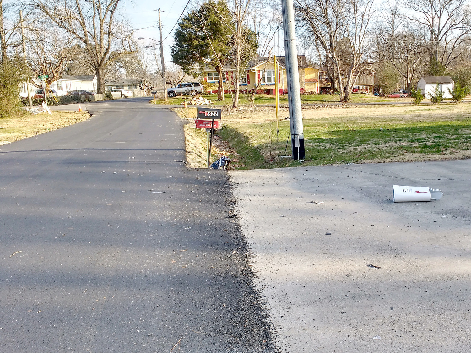 A MAILBOX ON Julian Drive was struck by a passing vehicle and tossed into this driveway. Residents of the neighborhood say traffic uses the community's streets as alternate routes and have severely damage the pavement.