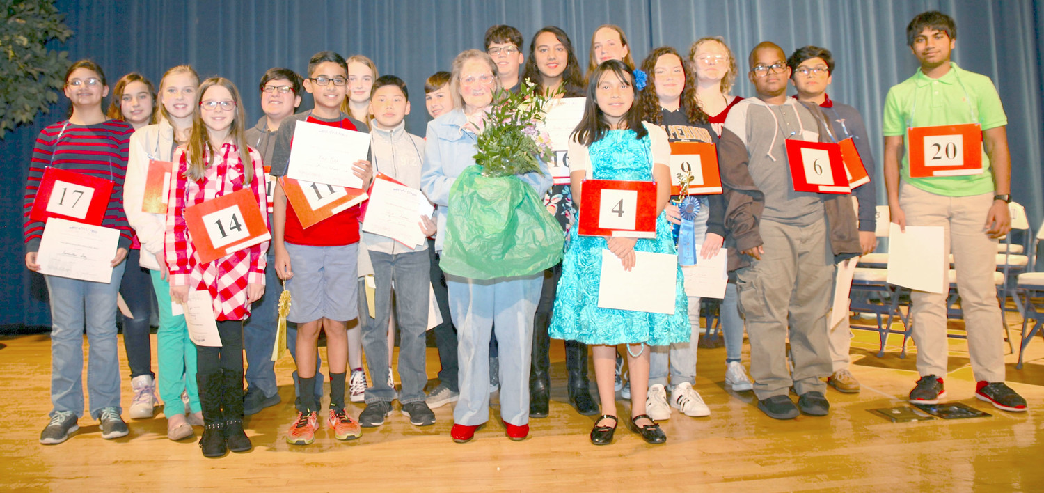 ALL PARTICIPANTS joined Mildred Maupin, a retired teacher and spelling bee coordinator, on stage to close out the 2018 spelling bee.