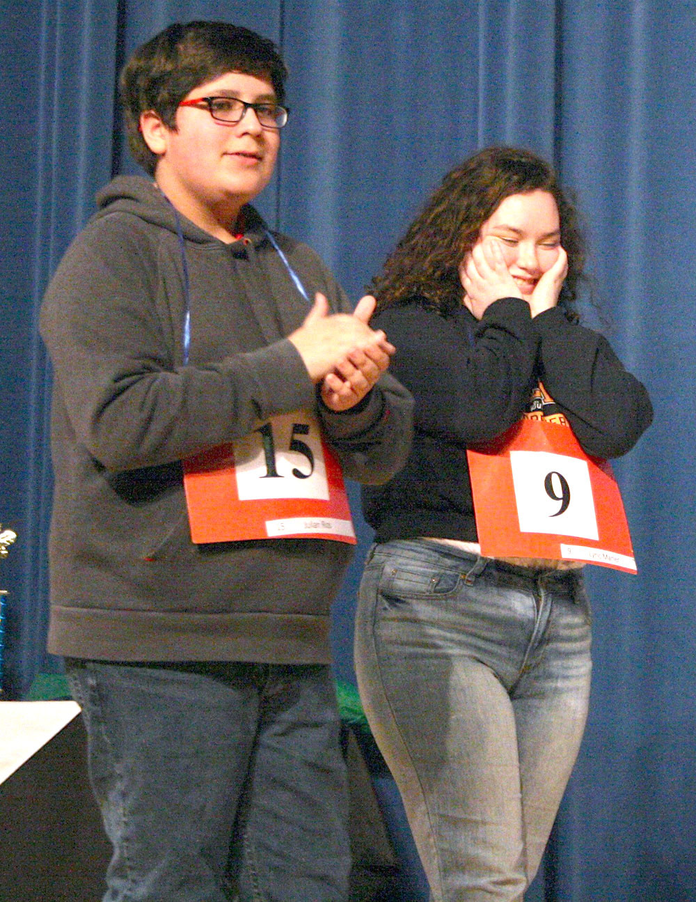 CLEVELAND MIDDLE eighth-grader Lyric Marler, right, reacts as she is named the winner of the Mildred Maupin Spelling Bee. With her is second-place winner Julian Rios.