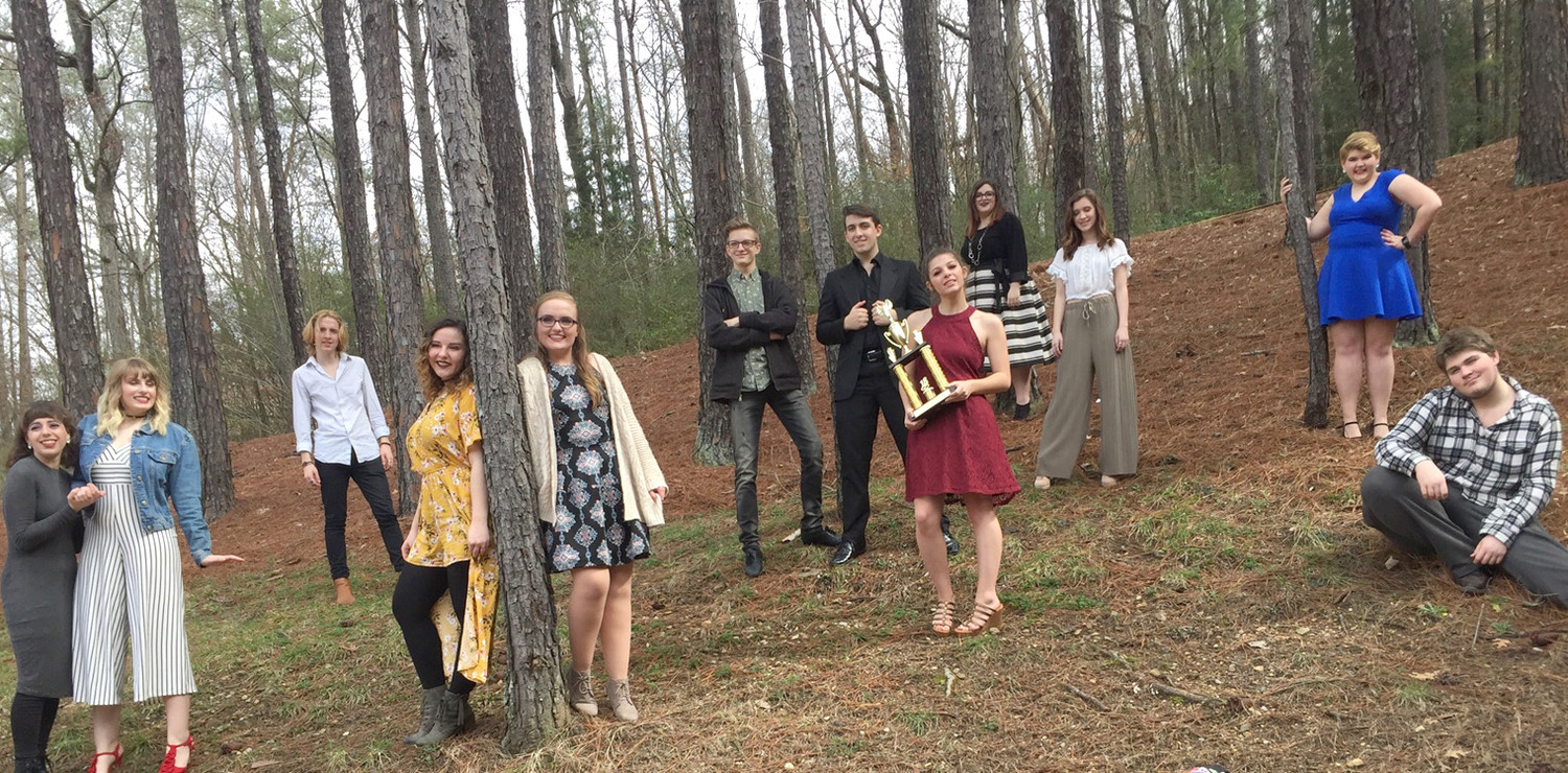 Senior members of Renaissance take a moment to pose with third-place trophy after competition.  From left are Alix Singleton, Macy Rexroad, Zech Dupree, Maddi Hill, Cassie Jones, Ethan Lawson, Christian Luithle, Lindsay Markham, Olivia Anderson, Savannah England, Olvia Swartzel and Chris Smith.