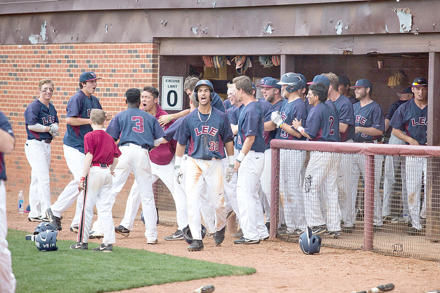 LEE UNIVERSITY teammates celebrate Jumpei Akanuma, fifth from left, no-hit effort against West Alabama on Saturday. afternoon