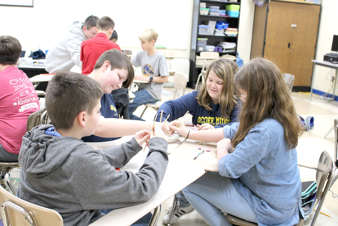 LAUGHTER was evident on the faces of many of the Ocoee Middle School students taking part in a game using chopsticks which Victoria White of Denso was leading.