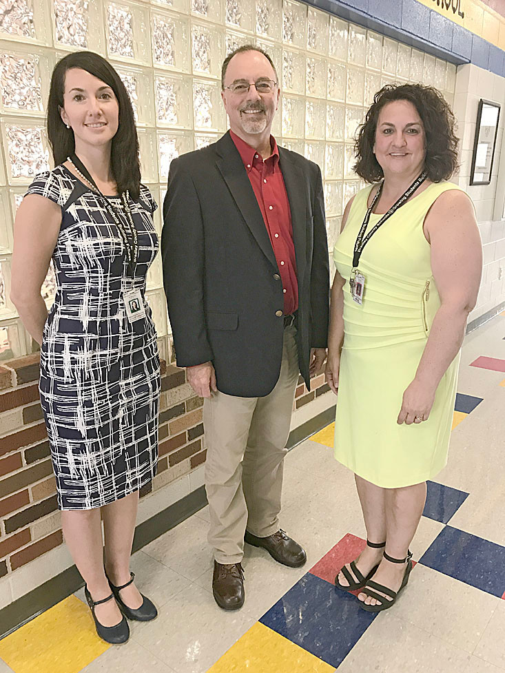 State Sen. Mike Bell recently visited Waterville Community Elementary School. Here, he spends time at the school with Heather Hayes, left, Waterville's dean of students, and Waterville Principal Jennifer Huskins.