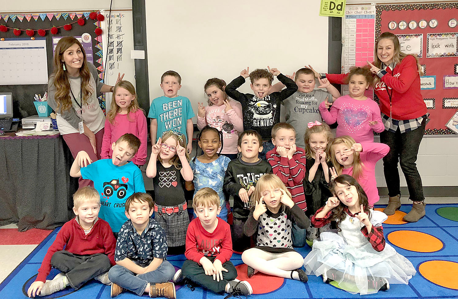 Kindergarten students at Waterville Community Elementary School turned Valentine's Day into an opportunity to learn about friendship. Students had to complete a scavenger hunt to find friends who had something in common with them (right photo). At left, Mrs. Bacon's class clowns around for the camera, but in a friendly way. Students were treated to a Friendship Ice Cream Party where they could celebrate their friendships, new and old, according to instructional coach Amanda McDonald. 
