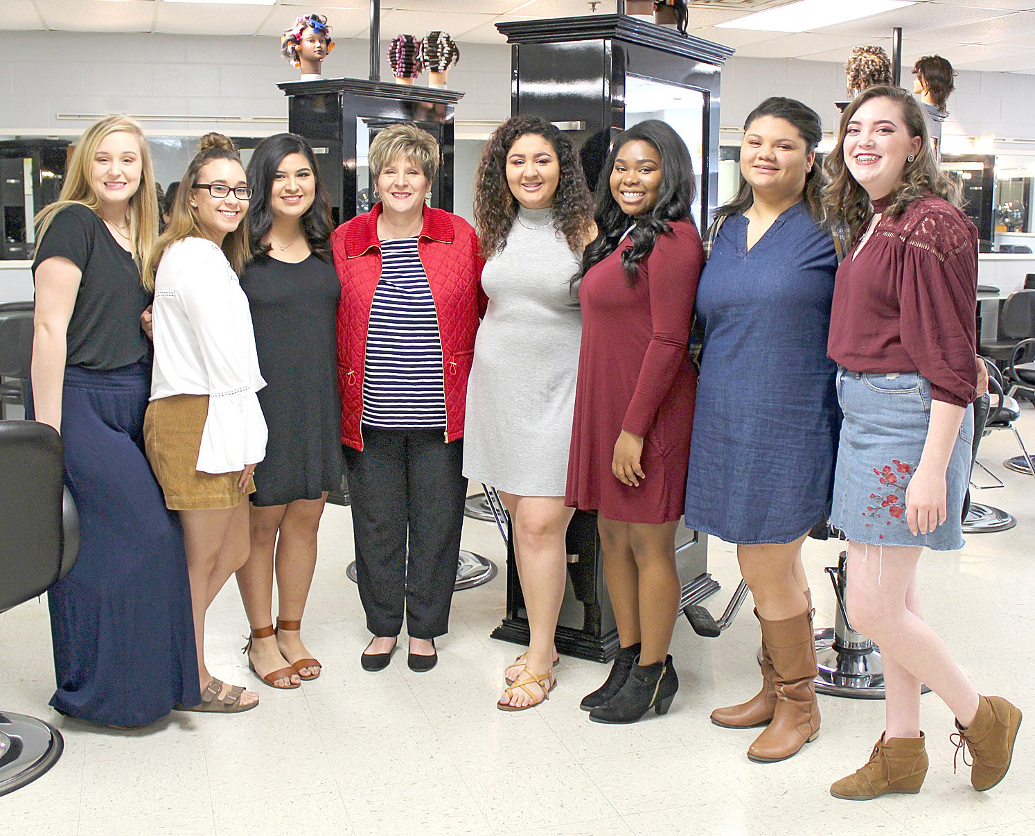 CLEVELAND HIGH SCHOOL cosmetology students are seen here in their classroom which has received $30,000 worth of new equipment. The classroom's makeover includes new pedicure stations, hair-washing stations, dryer chairs, manicure tables and hairstyling stations, among other improvements.