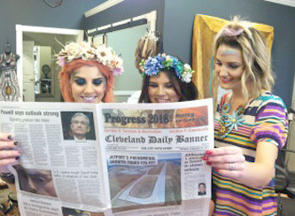 Look who's reading the Banner — Machelle McCulley, Bianca Gonzalez, and Kayla Harris of Vindima Salon just love the look and design of the Banner's progress edition.  They especially liked the bright and vivid color of the photos in the community section.