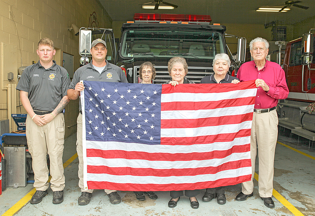WOODMEN LIFE REPLACED the American flag for Bradley County Fire-Rescue Station 1-Taylor on Thursday.  From left are Engineer Justin Frey, Firefighter Howard Millsaps, Christine Miller, Joyce Johnson, Eula Kile and W.W. Johnson.
