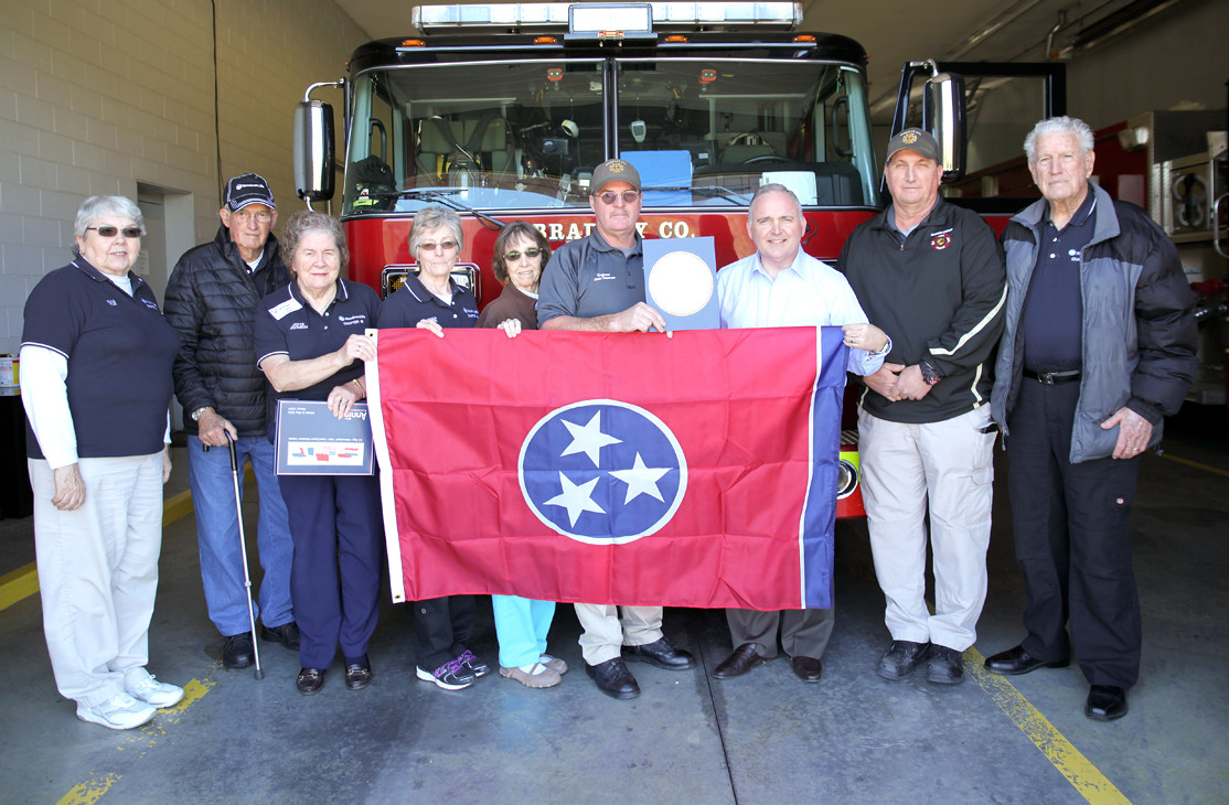WOODMEN LIFE REPLACED the Tennessee flag for Bradley County Fire-Rescue Station 13-Hopewell on Friday. Along with the flag, BCFR were presented with a certificate stating that the flag was flown over the capital in Nashville.  From left are Eula Kile, Jack Snyder, Joyce Johnson, Rebecca Snyder, Christine Miller, Engineer Jack Freeman, Rep. Kevin Brooks, Captain James Thompson and W.W. Johnson.