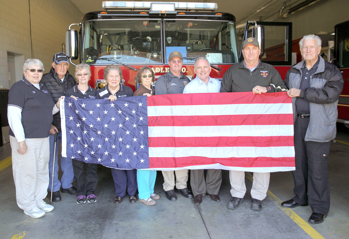 WOODMEN LIFE REPLACED the American flag for Bradley County Fire-Rescue Station 13-Hopewell on Friday. From left are Eula Kile, Jack Snyder, Rebecca Snyder, Joyce Johnson, Christine Miller, Engineer Jack Freeman, Rep. Kevin Brooks, Captain James Thompson and W.W. Johnson.