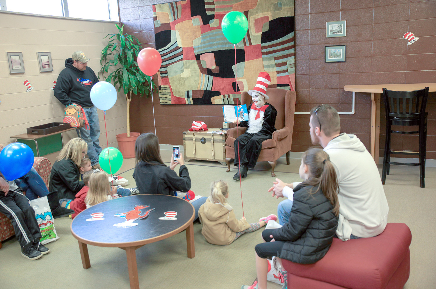 THE CAT IN THE HAT reads a story to several children and parents on Saturday during the event at CSCC.