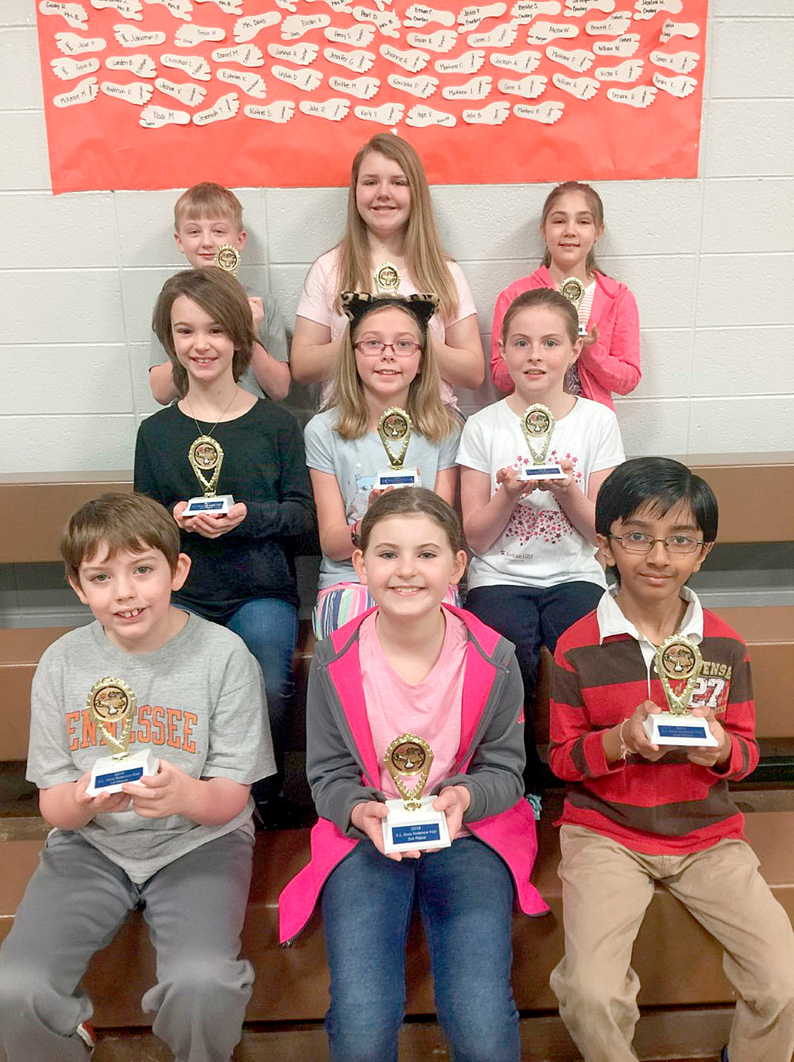 E.L. Ross 2018 Science Fair winners are, front row from left, Ben Stewart, first place; Julianna Burchfield, third; and Neel Patel, second. In row two are Eve Goforth, third; Ashley Pesterfield, first; and Maggi Creel, second. In back are Jaxson Collins, third; Natalie Clark, second; and Eva Laslie, first.