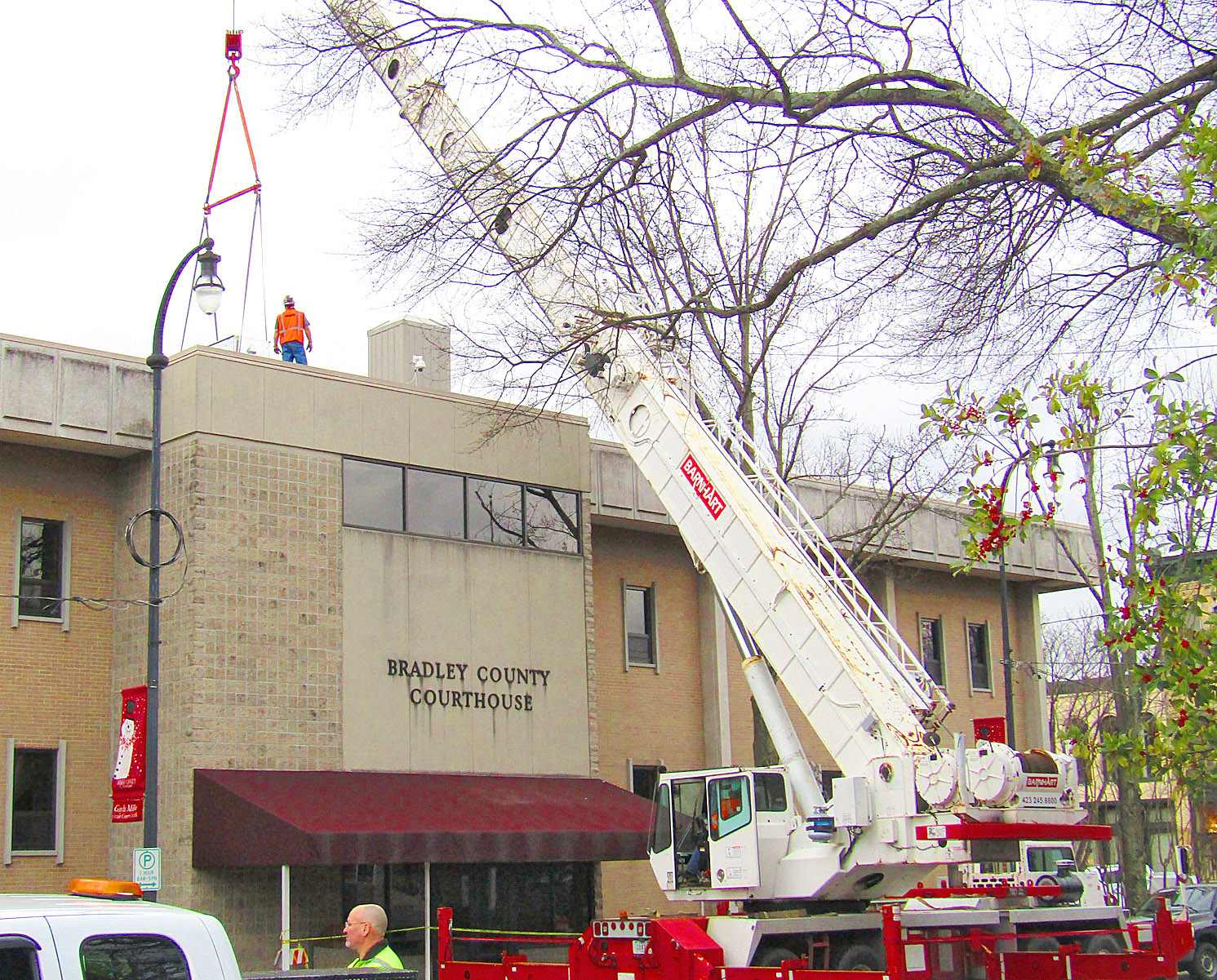 REPAIRS on the Bradley County Courthouse are progressing and remain on schedule. Bradley County Mayor D. Gary Davis reports the downtown building's reopening remains set for late April to early May. Here, a crane hoists portions of the new HVAC system to the roof.