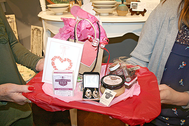 During the Galentine's Day event, attendees were able to enter a giveaway for a chance to win merchandise from the Museum Store valued at $50. Betty Parris was the winner, and won a pair of earrings made by Kyong Lee Sanders; lavender soap made with pure Appalachian beeswax, and raspberry creamed honey both from the Appalachian Bee; a Kiss Me Kit with edible lip scrub and healing lip balm made by Good Fortune Soap; a Valentine greeting card made by Sherry Johnson; a Museum Center keychain and lapel pin; and a handmade pendant necklace made and generously donated by Barbara Krasman.