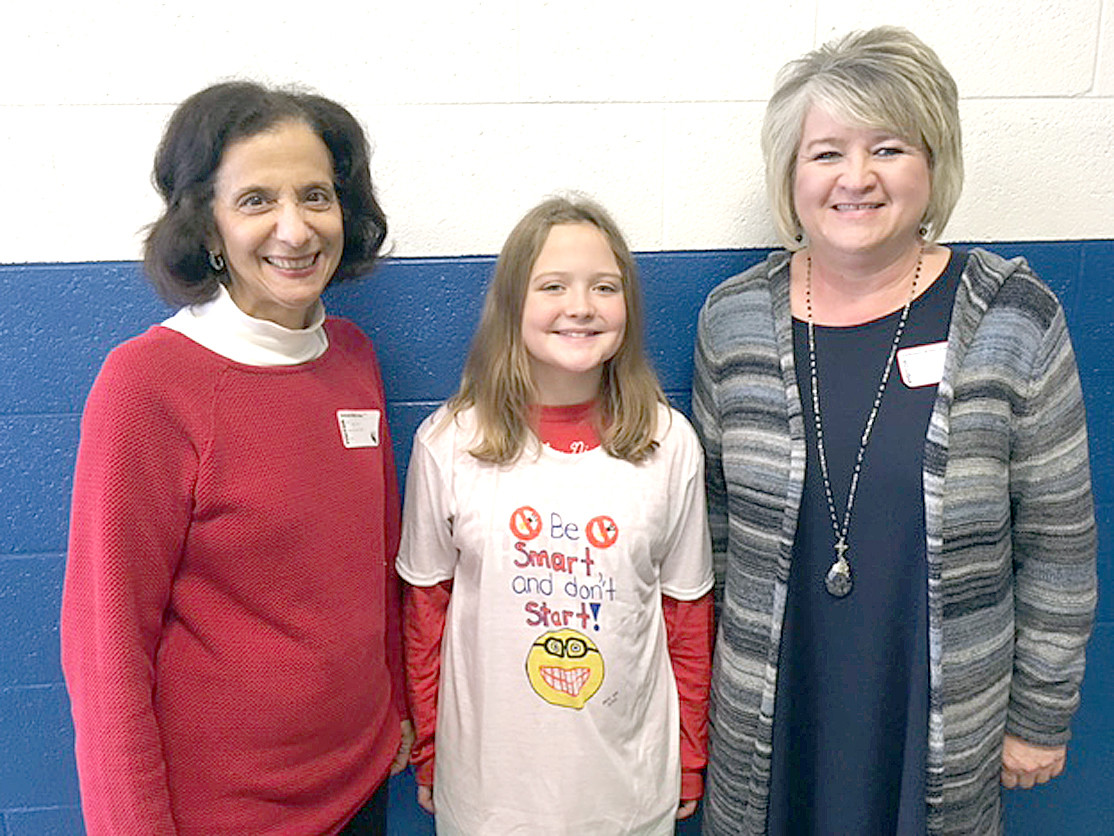CMS Tobacco T-shirt winner Alyx Dill poses with Joyce Clem and Jeannie Bentley.