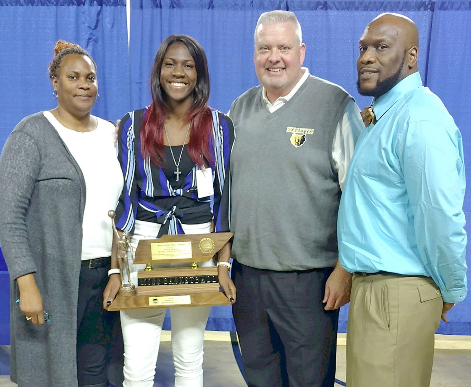 BRADLEY CENTRAL superstar point guard Rhyne Howard became the state's winningest program's second-ever Miss Basketball recipient. From left are her mother, Rhvonja Avery, Howard, Bearettes head coach Jason Reuter and uncle Mark Smith.