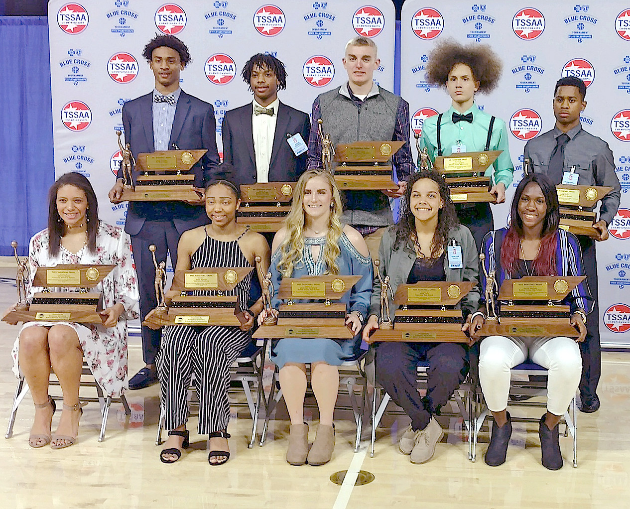 MR. AND MISS BASKETBALL winners pose with their awards in the MTSU Murphy Center on Tuesday evening. Bradley's Rhyne Howard (in the front row at far right) has been on a tear, averaging over 29 points per game this postseason as her team looks to make a run to the state finals this week.