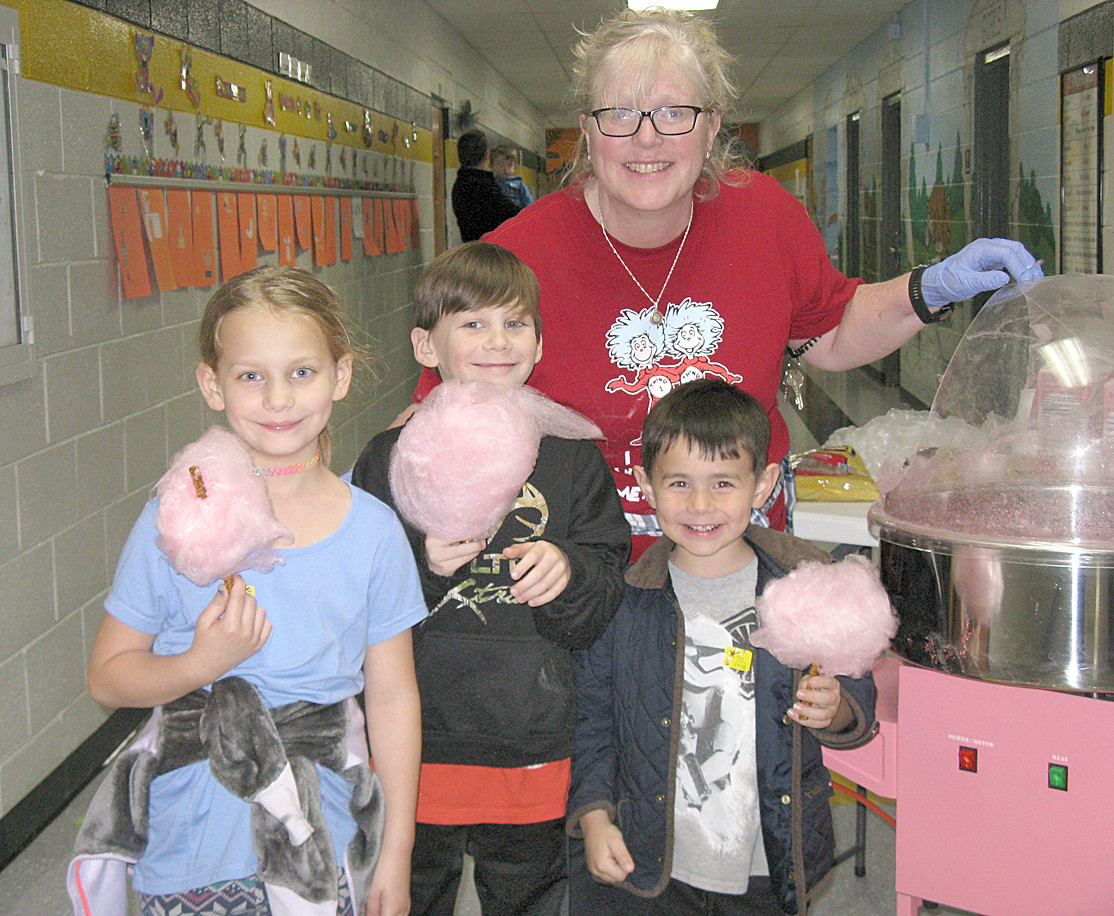 Hopewell students, along with Mrs. McChensey, enjoy the freshly made Truffula Trees (sometimes known as cotton candy) as part of Seuss in Schools.