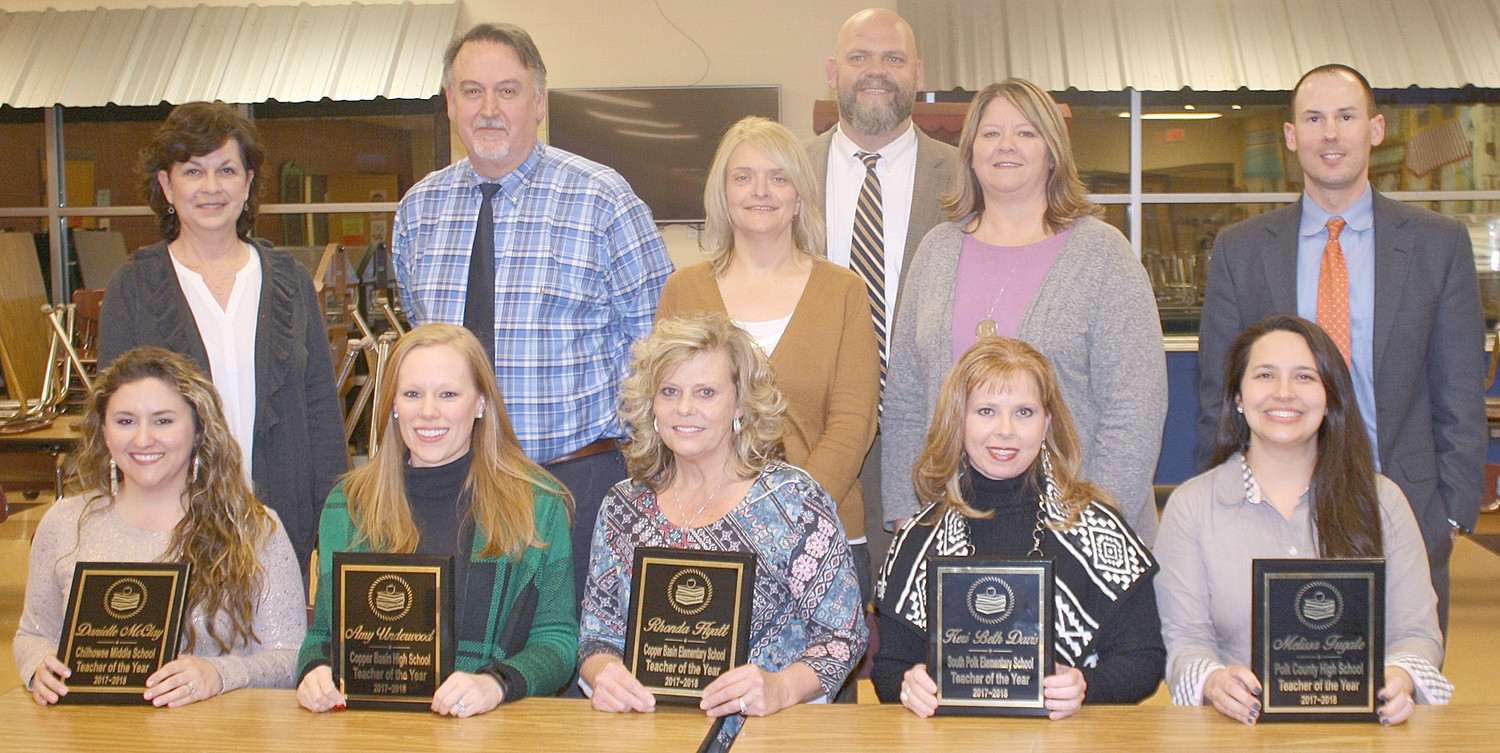 The POLK COUNTY Board of Education recognized the school system's Teachers of the Year Monday evening at Copper Basin High School. The award winners included, seated from left, Danielle McClary of Chilhowee Middle School, Amy Underwood of Copper Basin High School, Rhonda Hyatt of Copper Basin Elementary, Keri Beth Davis of South Polk Elementary, and Melissa Fugate of Polk County High School. Administrators making the presentations included, standing from left, Chilhowee Middle Principal Connie Dunn, Copper Basin High School Principal Tim Kidd, Copper Basin Elementary Principal Jill Franklin, Director of Schools Dr. James Jones, South Polk Principal Frances Bramlett, and Dr. Jason Bell, who stepped in for Polk County High School Principal Ron German.