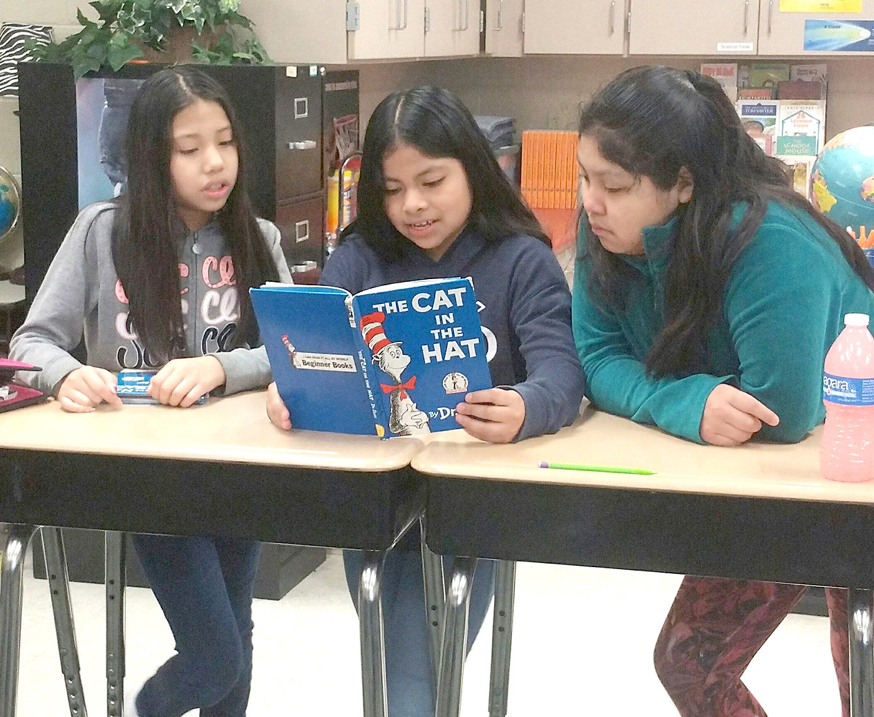 Fifth-graders Madeline Perez, Angelina Nicholas-Juan and Belinda Balthazar-Gaspar enjoy some DEAR (Drop Everything And Read) time during Dr. Seuss week at Blythe-Bower Elementary School.