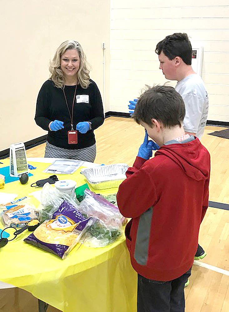 Amy Davenport of the Bradley County Health Department worked with youth to teach them how to pit an avacodo and dice radishes to make a delicious veggie wrap.