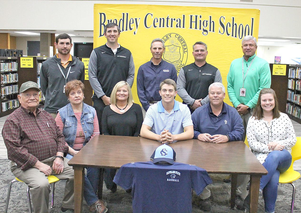 BRADLEY CENTRAL senior shortstop Pete Williams announced earlier this week that he will continue his baseball career at Cleveland State. Joining in the celebration were, seated from left,  grandparents Lance and Lynda Byrd, mom Angie Williams, signee Pete Williams, dad Jack Williams and sister Noa Williams. Also present were, standing from left, Bradley assistant coaches Timmy Lynn and Matt Day, CSCC head coach Mike Policastro, Bear head coach Travis Adams and CHS assistant principal Greg Geren.