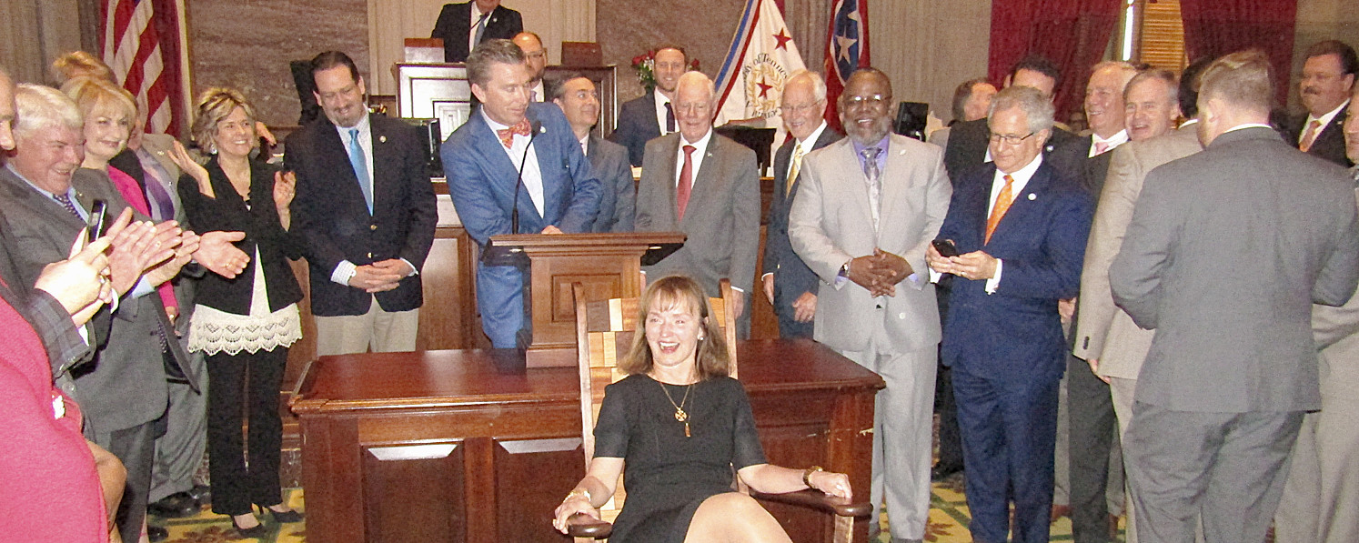 Speaker of the House Beth Harwell is surprised by her colleagues by a rocking chair presented by the State Legislature as she prepares to leave office at the end of the session.
