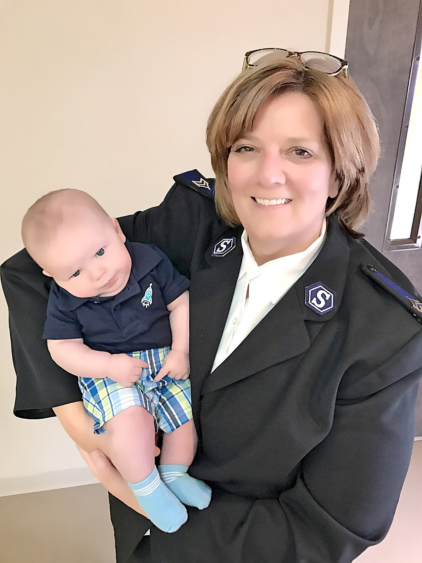 Salvation Army Commander Ruthie Forgey is shown during a recent baby dedication.