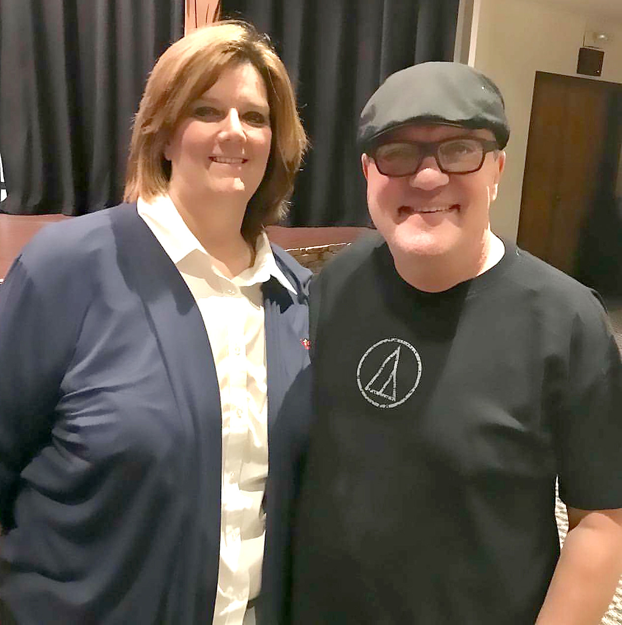 Christian comedian and musician Mark Lowry shares a laugh with Sgt. Ruthie Forgey during his recent visit to benefit the local Salvation Army.