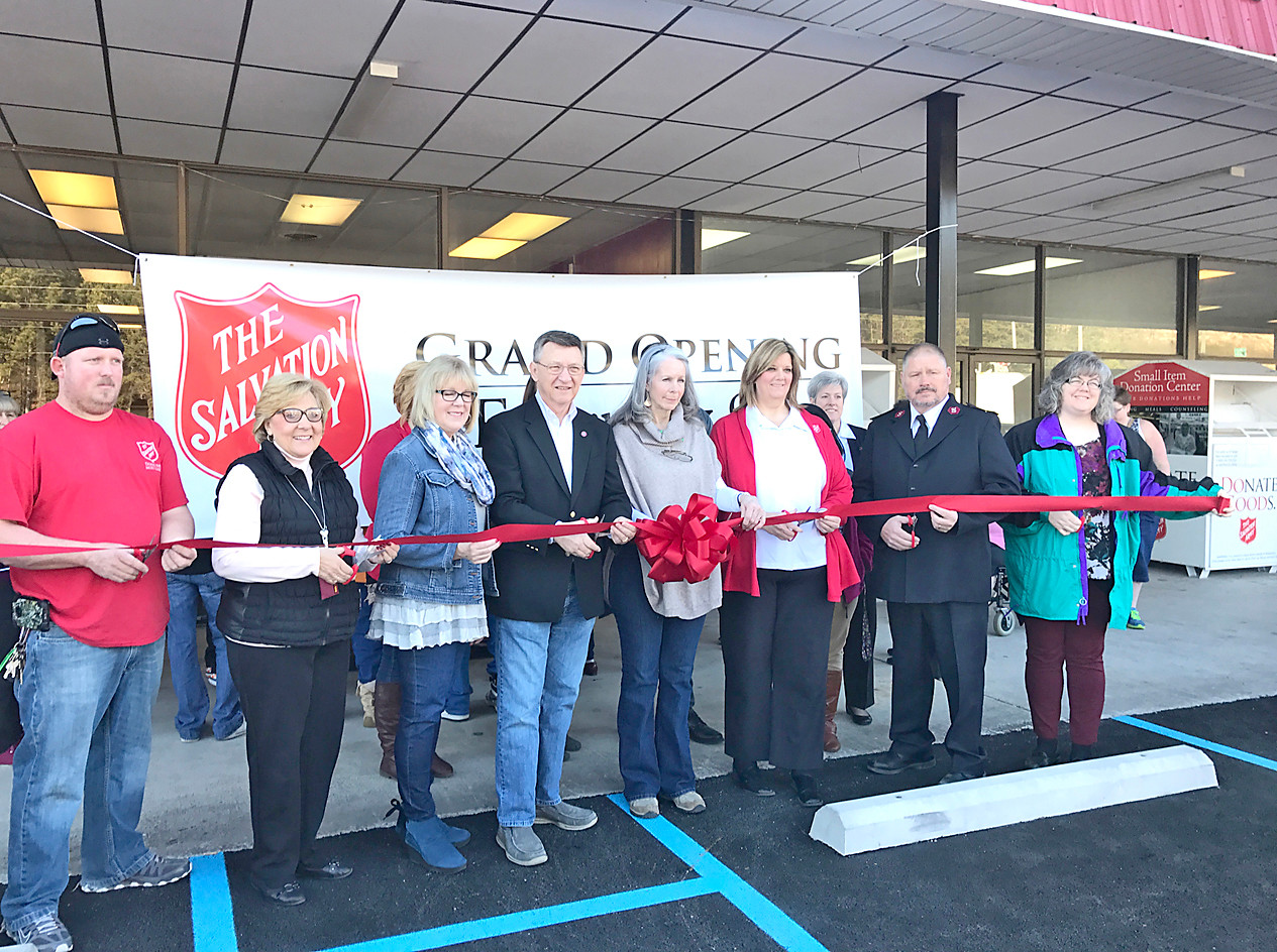 Sgt. Ruthie Forgey, third from right, was on hand for the recent grand opening of the new Salvation Army Family Store on South Lee Highway.